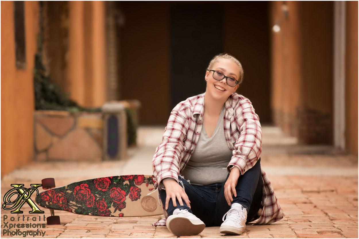 senior girl with skateboard