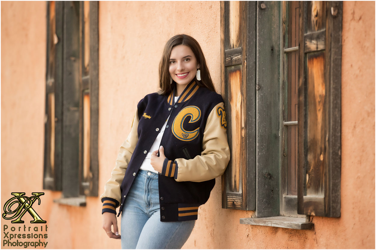 high school senior girl with letterman jacket.