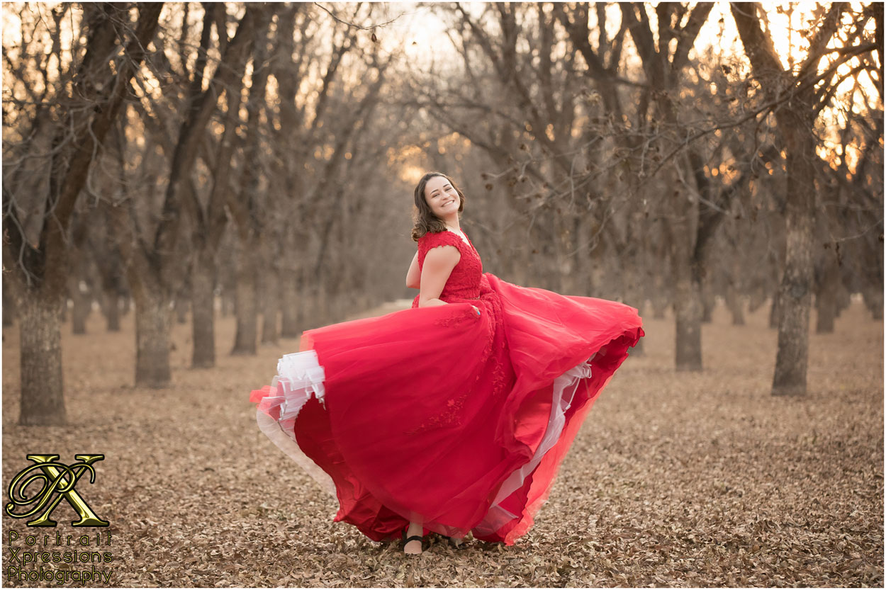 high school senior in red dress in El Paso