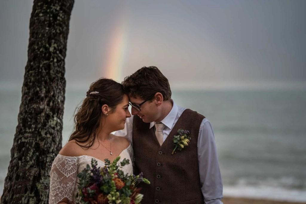 Environmental Bridal portrait under palm tree with rainbow