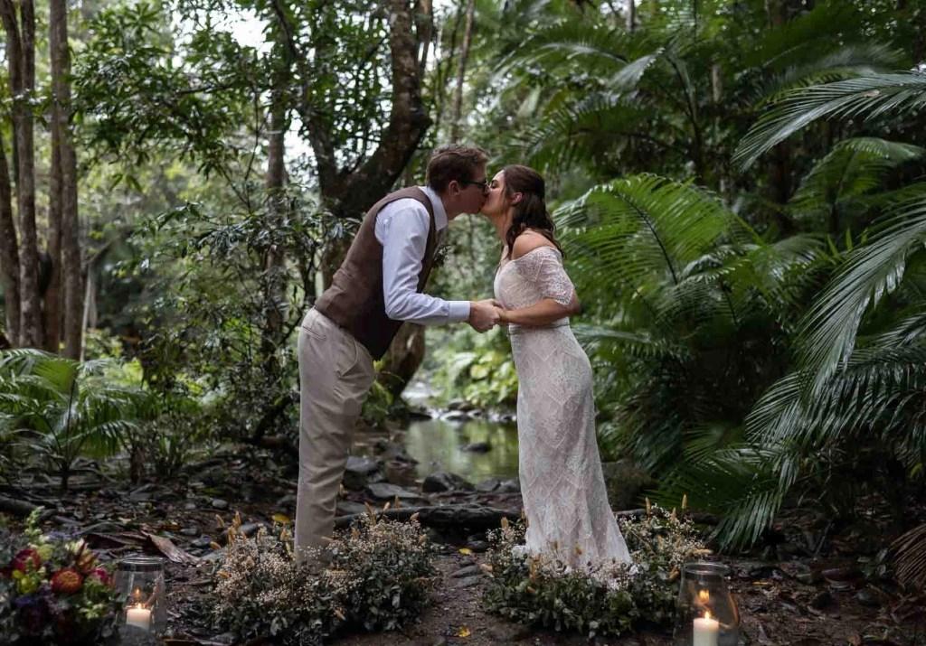Kissing in the rainforest secret elopement photography