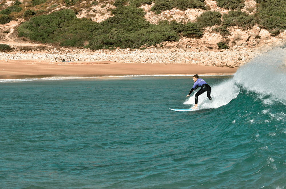 Woman surfing in Portugal