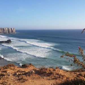 View from the hill on surfing waves on the Tonel beach in Sagres Portugal