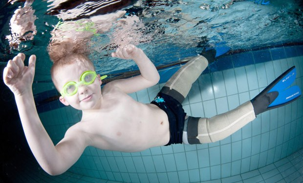 They call him Flipper! Meningitis amputee, 7, learns to swim with prosthetic fins