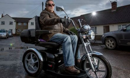 Easy rider! 64-year-old Hells Angel is chased by police for driving his 8mph 'Harley Davidson' mobility scooter on the pavement (but it IS legal)