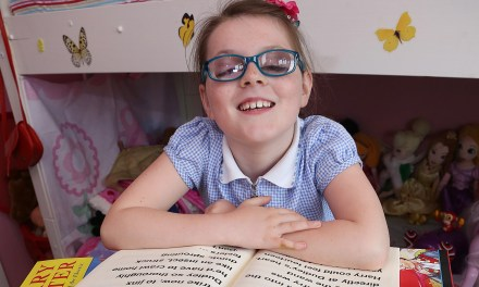 World's Largest Harry Potter Books? Blind Children UK presents vision impaired eight-year-old with giant Harry Potter books, signed by the author