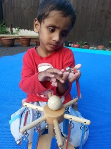 Avyukt Acharya with one of the toys from a Newlife Play Therapy Pod