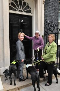 Delivering the petition. From left: Gill Southgate and guide dog Yaz, Cynthia Easeman and guide dog Olivia, and Genene Henshaw and guide dog Susan.