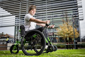 DMU Student Ben Cook tests the university loan off road wheelchair.