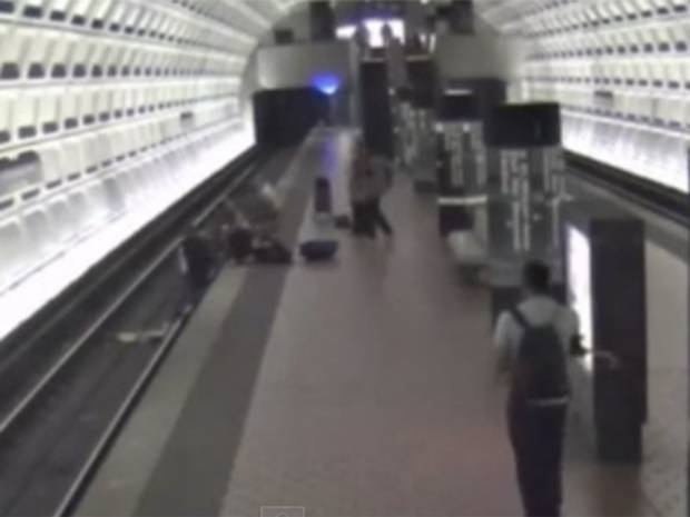 Commuters jump on to tracks to save man in wheelchair who had fallen from platform