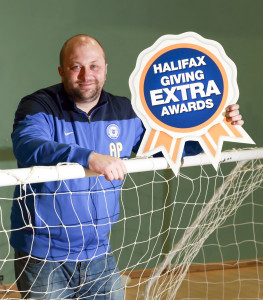 Andrew Palmer celebrates winning the local Halifax Giving Extra Awards for Peterborough.