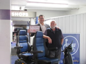 Andy Nash (Manager, the Belfry Shopping Centre) and Karl Grouse (Manager, Shopmobility Redhill)