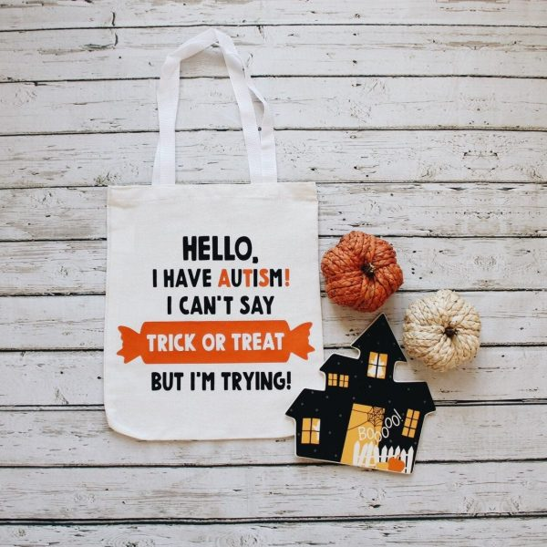"A tote bag to take trick or treating on Halloween. The text on the bag reads ""Hello. I have autism! I cant say trick or treat, but Im trying!"""