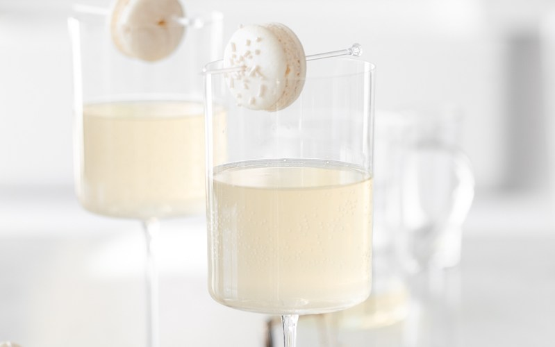Sparkling Vanilla Macaron Cocktail recipe, made with just a few simple ingredients and a french macaron garnish.