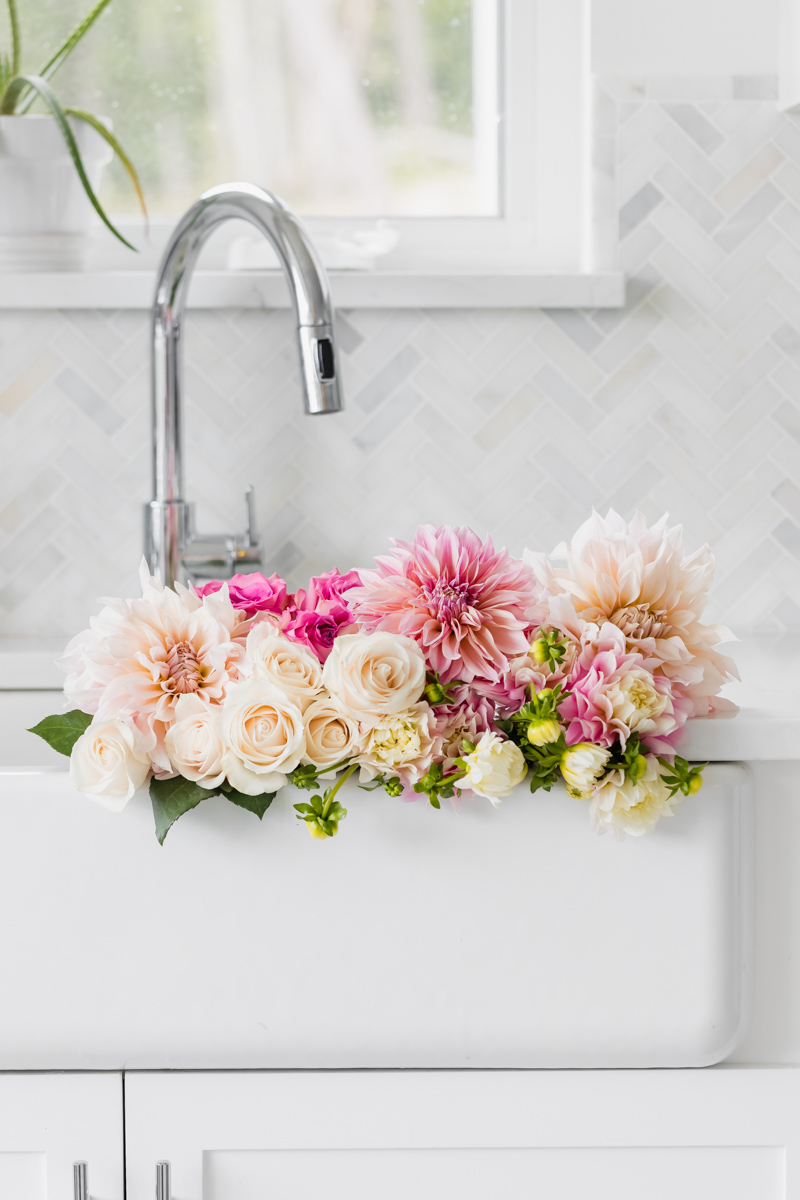 Fresh flowers in a white sink - dahlias roses