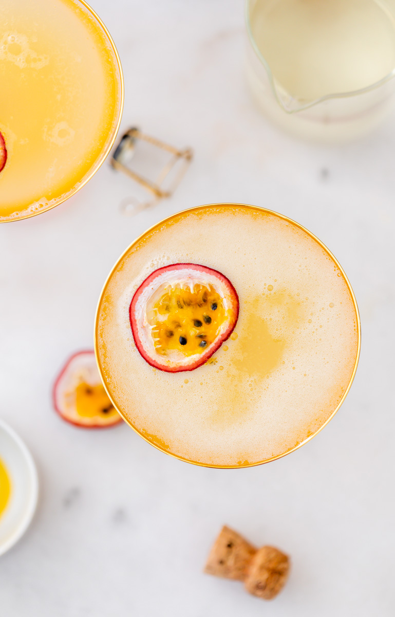 Light and refreshing passion fruit French 75 cocktails for spring and summer. Just for ingredients! Recipe and quick video included!