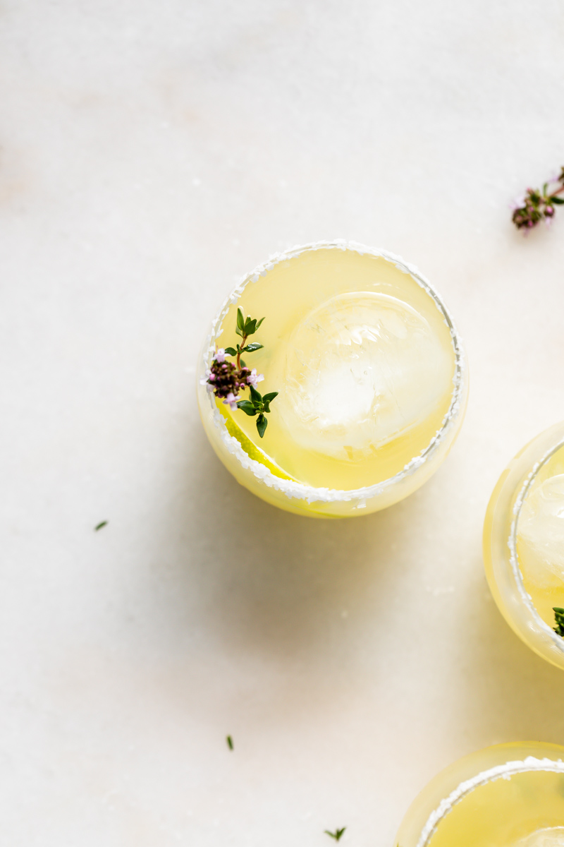 Thyme infused margaritas made with homemade thyme simple syrup, fresh lime, tequila and cointreau. The perfect herbal garden cocktail recipe for spring and summer entertaining.