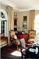 Formal Old Hollywood Living Room with Antiques