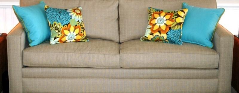 modern khaki sofa with colorful pillows