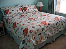 Custom bed treatment for resort rental from Posh Surfside