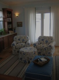 Slipcovered club chairs, large blue and white print