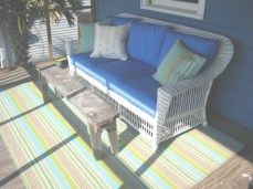 Whitecraft Outdoor Wicker Sofa with Dash and Albert Rug and Pillows