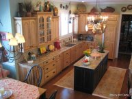 The warm wood kitchen has Soumack carpet runners