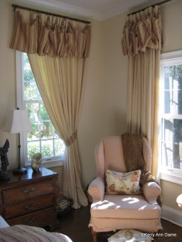 Relaxed linen draperies in the master bedroom have soft striped valances