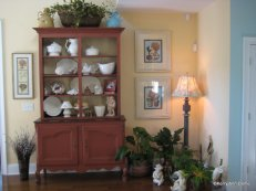 French country cupboard with a collection of white pottery