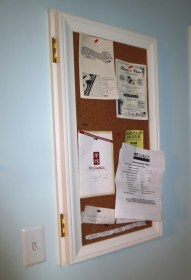 A corkboard on a hinge conceals the electrical panel
