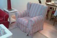 A big, comfy winged club chair is slipcovered in a washable multi-stripe