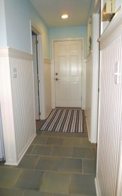 Wainscoting added to the entry protects walls