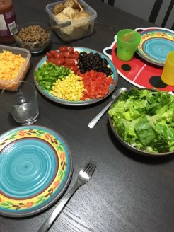 taco salad fixings in bowls on dark brown table_man food makeover__positively nourishing nutrition consulting