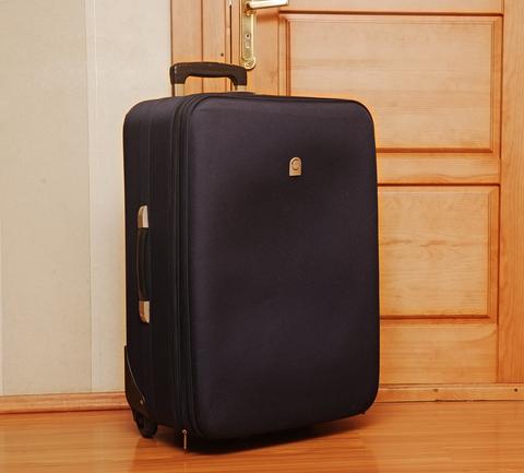 Suitcase by door