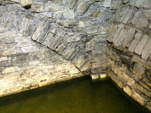 The base of the old castle where the moat used to be - water still fills a small portion.