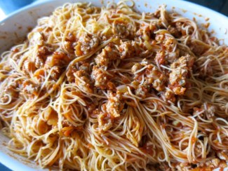 Spaghetti with sauce mad with pork sausage, onion, and garlic
