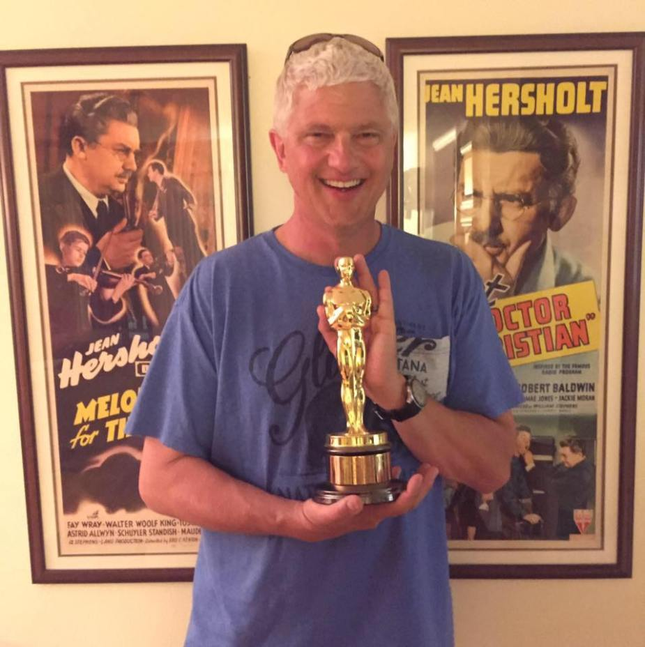 Gavin holding the original Jean Hersholt Humanitarian Award
