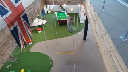 A game of pool in progress in the middle of the work day.