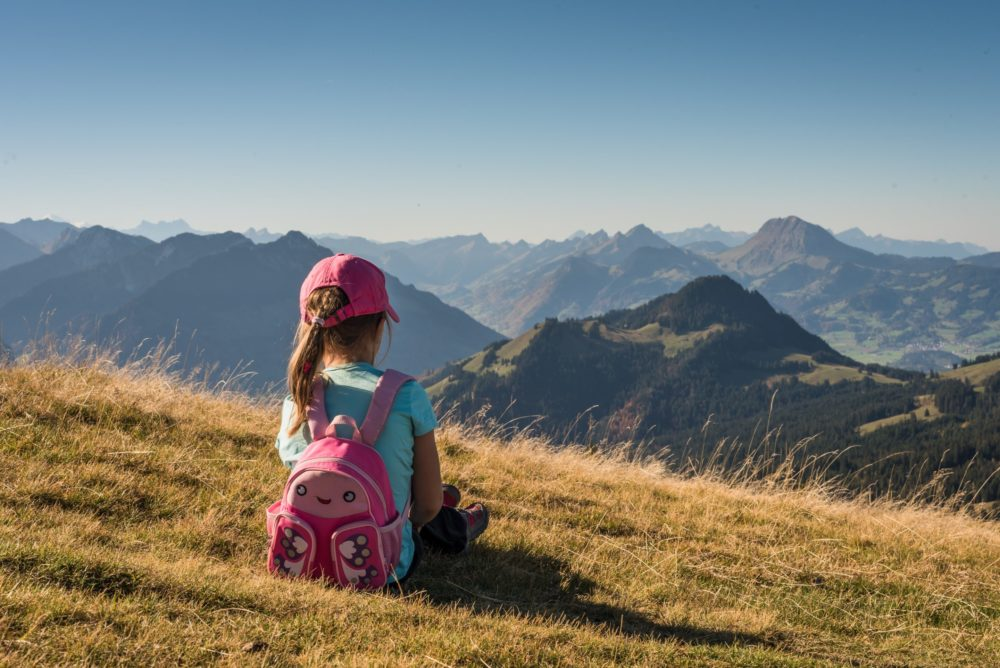 girl alone on hill