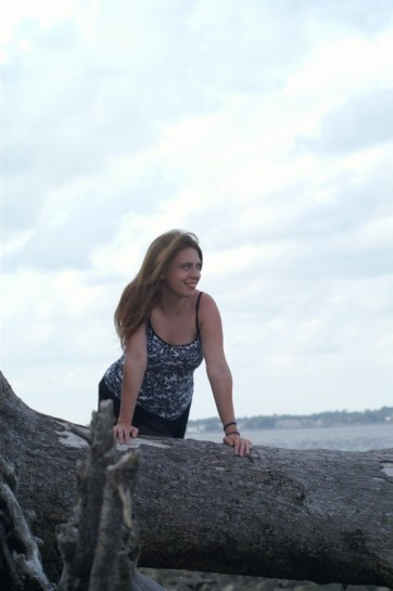 Me on a piece of driftwood at Driftwood Beach. Driftwood Beach is a beautiful part of Jekyll Island.
