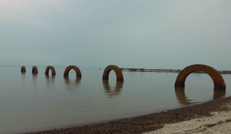 Brick arches disappear into the tide