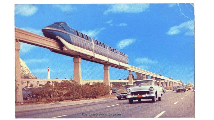 """America's first daily-operational monorail trains transport passengers over a concrete """"highway in the sky"""" between Disneyland and the Disneyland Hotel on the Disneyland-Alweg monorail system. (Postcard)"""