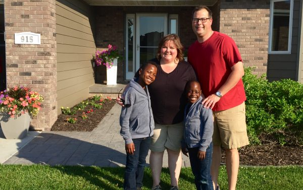 Ronald, Ann, Sam, and Steve outside our home in Nebraska.