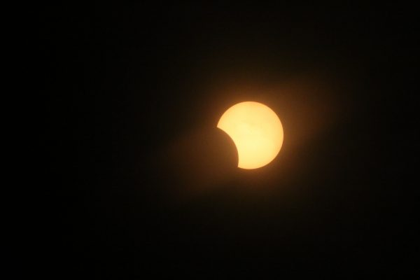 Partial solar eclipse photographed by Ronald D. Koch in Crete, Nebraska.