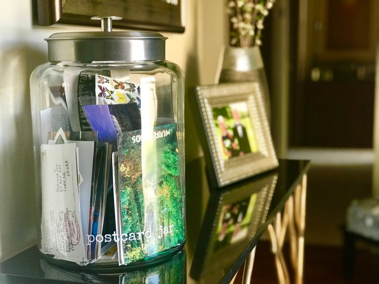 Our postcard jar that sits on a table in our front entry.