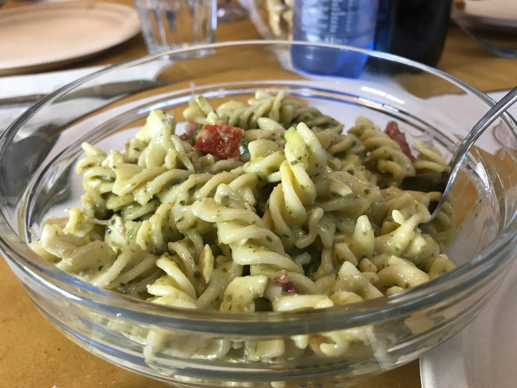 Delicious Tuscan food pasta with pesto at Antica Salumeria Salvini, Siena, Italy