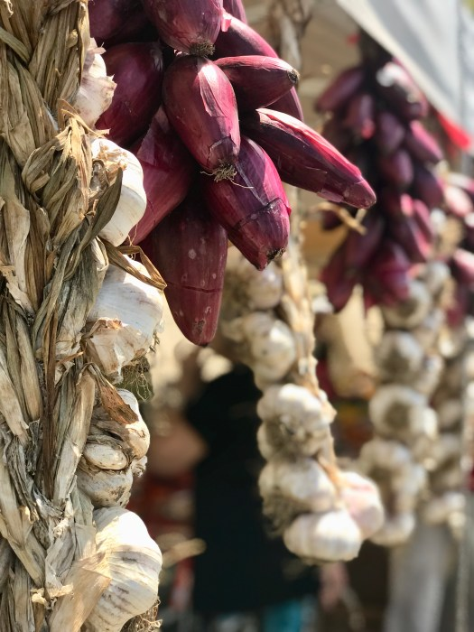Fresh garlic and onions at a roadside stand used in delicious Tuscan food