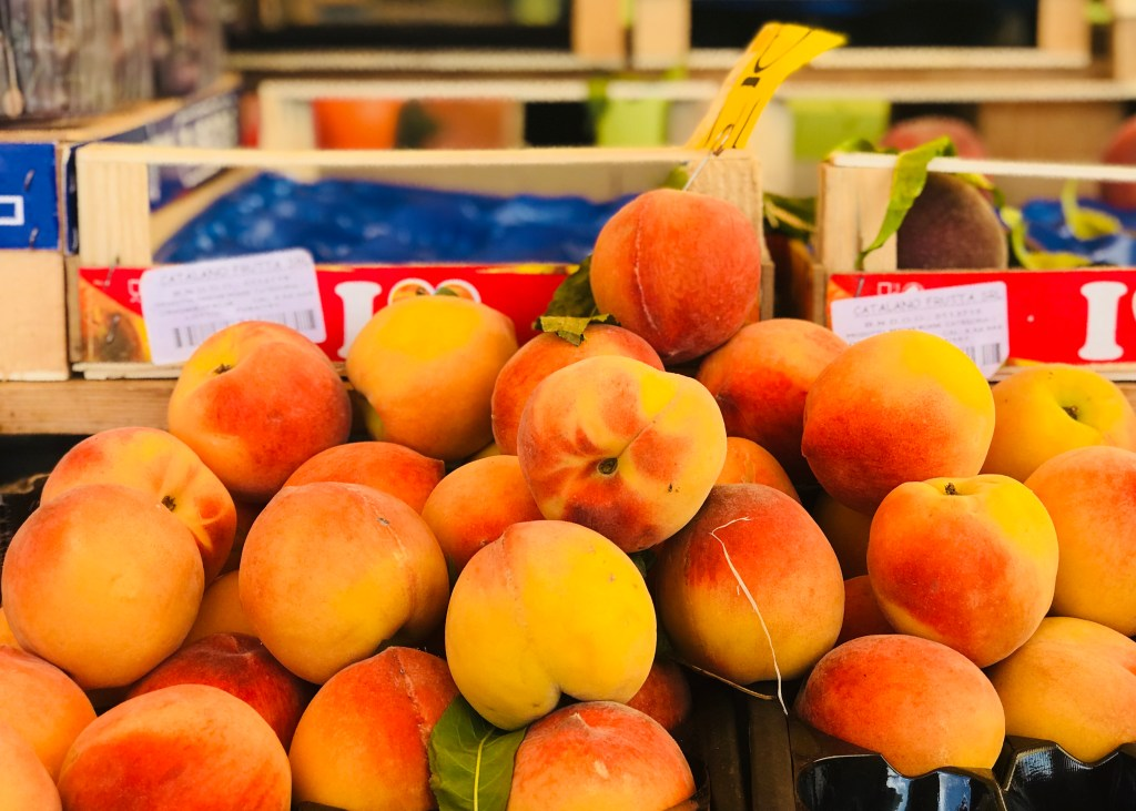 Peaches in the farmers' market, Siena, Italy, used in delicious Tuscan food