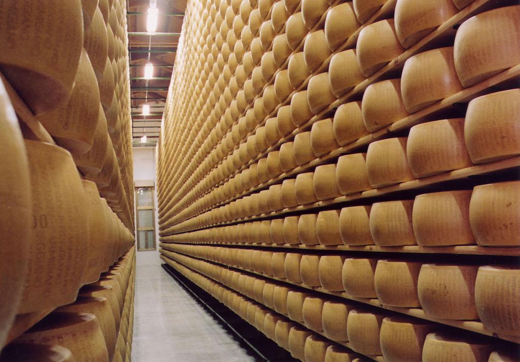 Parmigiano-Reggiano cheese wheels aging