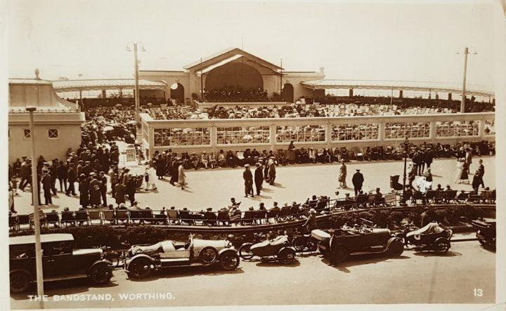 Vintage car postcard of grandstand Worthing
